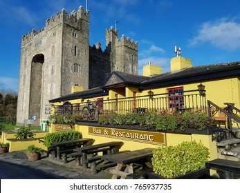 Bunratty Castle and Durty Nelly's Irish Pub, Ireland - Nov 30th 2017: Beautiful view ofIreland's most famous Castle and Irish Pub in County Clare. Famous world tourist attraction.