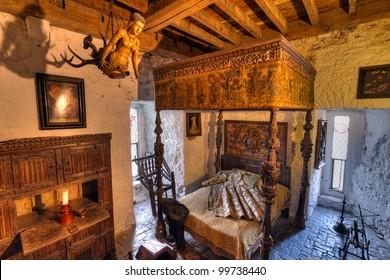 BUNRATTY, IRELAND - FEB 19: Ancient bedroom interior of 15th century Bunratty castle, traditional Irish tourist attraction of Co. Clare - Feb 19, 2012 in Bunratty Castle, Co. Clare, Ireland.