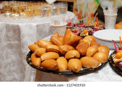 Buns and desserts on restaurant table