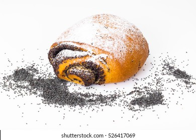 Buns with poppy seeds and icing sugar. Studio Photo