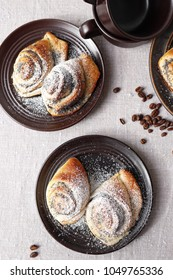 Buns of yeast dough with poppy seeds.