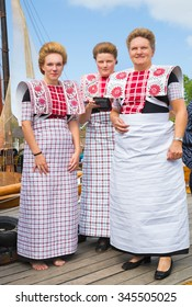 BUNSCHOTEN-SPAKENBURG, THE NETHERLANDS - SEPT 5, 2015: Local women are dressed in traditional fisherwomen dresses during the annual fishery day