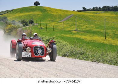 BUONCONVENTO (SIENA), ITALY - MAY 14: Vintage cars (1952 Jaguar C-Type, 1954 Mercedes Gullwing) driven by Frankel-Fowler and Binder-Capparoni at 1000 Miglia race on May 14, 2011 in Buonconvento, Italy