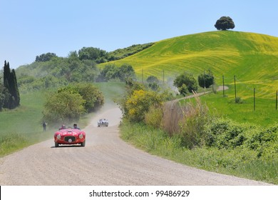 BUONCONVENTO (SIENA). ITALY - MAY 14:  A red 1951 built FERRARI 212 Export driven by Bernhard Sieber during a time trial at 1000 Miglia race on May 14, 2011 near Buonconvento (Siena)