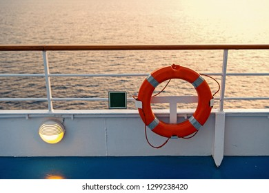 Buoy or lifebuoy ring on shipboard in evening sea in miami, usa. Flotation device on ship side on seascape. Safety, rescue, life preserver. Water travel, voyage, journey. Wanderlust, vacation, trip.