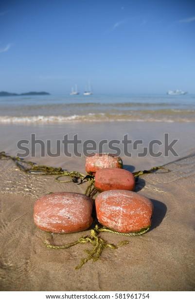 Buoy on the beach.