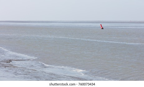 Buoy in the water - Waddensea in the Netherlands - Selective focus