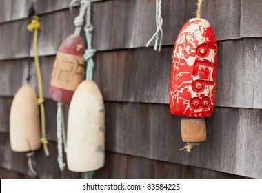 Buoys decorating a wall in Mystic, Connecticut, New England, United States of America, North America