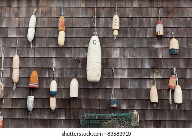 Buoys hanging on a wall in Mystic, Connecticut, New England, United States of America, North America