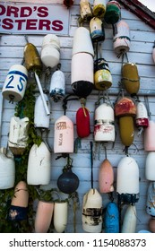Buoys hanging outside beach shack in Mystic, Connecticut