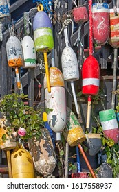 Buoys in Maine on the side of a building