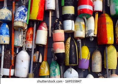 Buoys on the side of a beach shack