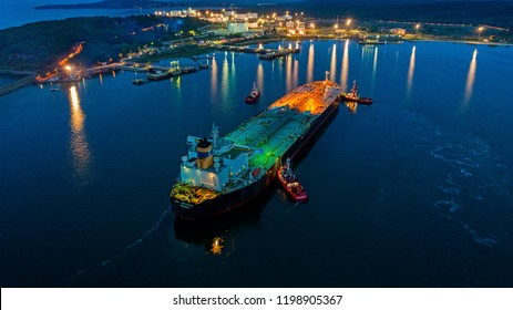 Burags/Bulgaria-May 06 2018:Aerial view oil tanker ship at the port at night, import export business logistic and transportation.