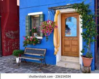 Burano island, Venice. Decorated facade of the house. Colorful houses island and landmark of Veneto region, Italy