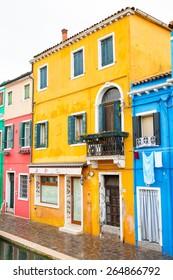 Burano Island, Venice, Italy - November 10, 2014: Venice landmark, Burano island, colorful houses and boats