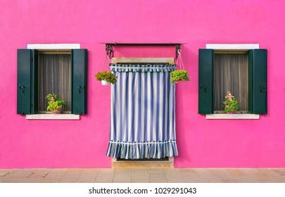 BURANO, ITALY - 2 Septenber,  2016. Pink color of walls in Burano island near Venice, Italy. Art minimalis