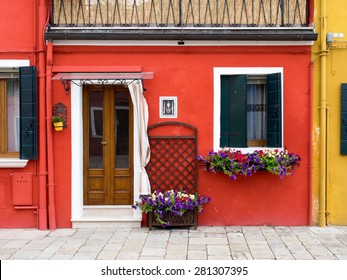 Burano, Italy - 21 May 2015: Red painted building. One of the many different coloured painted buildings on the island of Burano near Venice, Italy