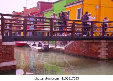 BURANO, ITALY - APR 16, 2018 - Brightly colored houses of Burano Venice, Italy