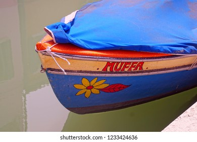 BURANO, ITALY - APR 16, 2018 - Traditional working boat of the Venice lagoon,  Venice, Italy