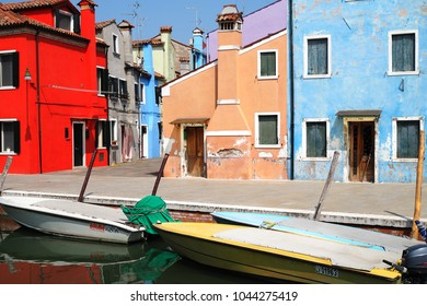 Burano, Italy- April 14, 2017: Typical colorful houses along a canal in Burano, Venice, Italy. Burano is a small island in the Venetian Lagoon