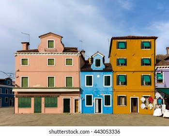 BURANO, ITALY - APRIL 30 2016: The Venetian island of Burano is known for its brightly colored homes. The colors of the houses follow a specific system originating in the middle ages.