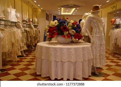 BURANO, ITALY - AUG 11, 2018 - Lace dresses and accessories in showroom of Burano Venice, Italy