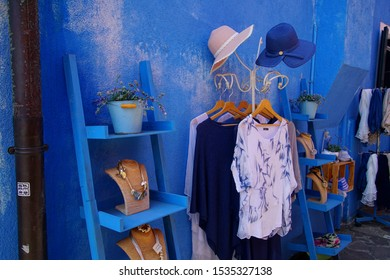 BURANO, ITALY - AUG 11, 2018 - Blue clothing and accessories in showroom of Burano Venice, Italy