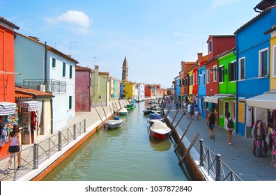 Burano, Italy. Aug 18, 2016. Photographed In Burano, Venice on a sunny day.Boat and Typical brightly painted houses and street in Burano, Italy