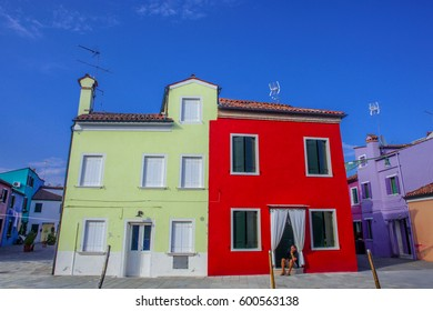 BURANO, ITALY - JULY 13: Colorful houses by canal on July 13, 2016 in Burano, Italy. Burano is an island in the Venetian Lagoon and is known for its lace work and brightly colored homes.