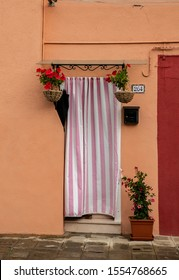 BURANO, ITALY, JUN 21, 2019: house door in Burano village near Venice, Italy