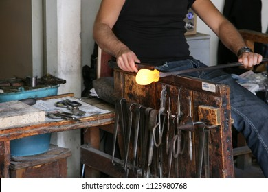 BURANO, ITALY - MAY 07, 2010: Glass Artist in her workshop making glassware