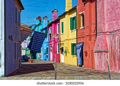 BURANO, ITALY - MAY 21, 2017: View on the streets of Burano, with colorful buildings and hanging clothes.