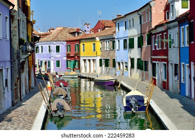 BURANO, ITALY - SEPT 26, 2014 : Canal with colorful houses on the famous island Burano. Venice and the Venetian lagoon are on the UNESCO World Heritage List