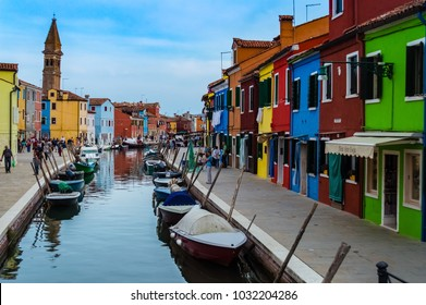 BURANO, ITALY, SEPTEMBER 14 2016: Colorful houses in the canal of Burano