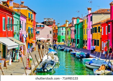Burano, Italy - September 4, 2016 : View of the colorful Venetian houses along the canal at the Islands of Burano in Venice on September 4, 2016.