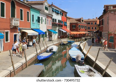 BURANO, ITALY-JUNE 20: Colorful houses along the streets along the canals on June 20,2017 in Burano italy island near Venice, part of the Venetian lagoon.