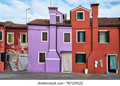 Burano, Venice. Colorful houses architecture at the square. Summer 2017, Italy