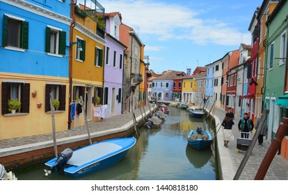 BURANO VENICE ITALY 05 13 2019: Burano is an island in the Venetian Lagoon near Torcello, known for its lace work and brightly coloured homes. The primary economy is tourism
