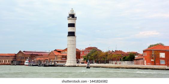 BURANO VENICE ITALY 05 13 19: Murano Lighthouse (Italian: Faro dell'Isola di Murano) is an active lighthouse on the island of Murano in the Venetian Lagoon on the Adriatic Sea.