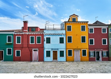 Burano, Venice. Old colorful houses architecture at the square. Summer 2017, Italy. Cloudy weather