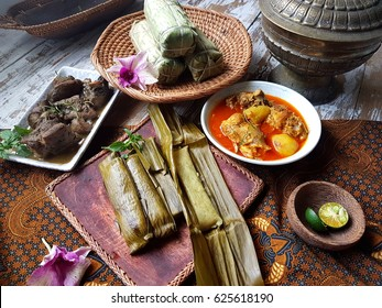 Burasa or buras is a type of rice dumpling cooked with coconut milk wrapped with banana leaf. Delicacy of the Bugis and Makassar people of South Sulawesi, Indonesia.