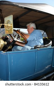 BURBANK CA - AUGUST 8: Comedian Jay Leno in his vintage car outside the NBC Studios August 8, 2011 Burbank, CA.