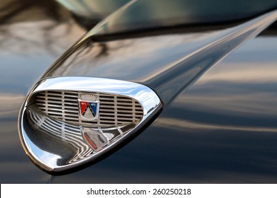 BURBANK, CA - FEBRUARY 20, 2015: Close up of a 1958 Ford Fairlane chrome scoop and emblem on a black hood. The car was named after Henry Ford's personal estate in Dearborn, Michigan.