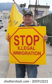 BURBANK, CA  JULY 19, 2014: A protester demonstrates against illegal immigration and amnesty for undocumented immigrants.