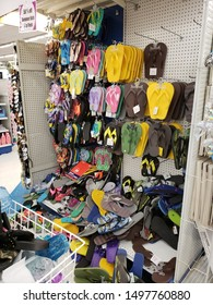 """Burbank, CA / USA - August 5, 2019: Pile of colorful flip flops. Summertime Sale 50% Off at 99 Cent Only Store."