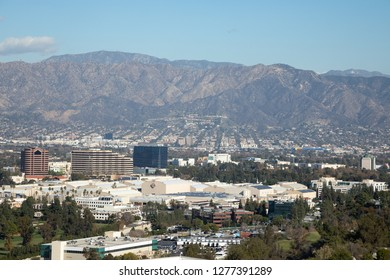 Burbank, California / USA - December 27 2018: Elevated view of Burbank California, with Warner Brothers Studios sound stages for movie production, and Verdugo Mountains in the distance
