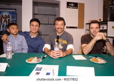 BURBANK - DEC 10: (L to R) Guest, Walter Gatus, Vince Toyama, Christopher Vacher, attends  Transformers Prime: Darkness Rising DVD Signing. December 10, 2011 in Burbank, CA