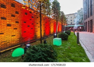 BURDENKO, September 15, 2019: Barbeque at the back yard, preparing for the party. Outdoor party with colorful landscape lighting