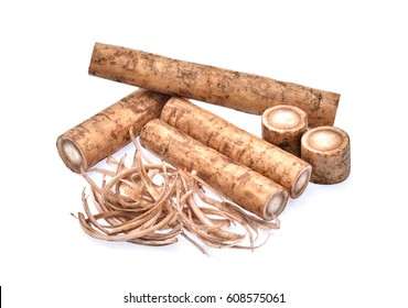 Burdock roots on white background