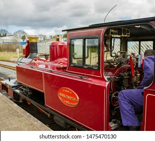 Bure Valley Railway, Norfolk, UK – March 17 2019. Train driver riding the small steam locomotive along the Bure Valley Railway, Norfolk.